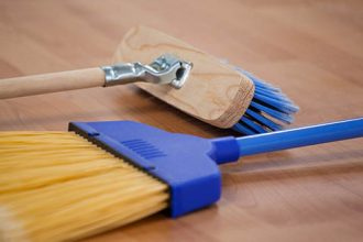 2 Brooms on Wood Floor Background | Class C Components