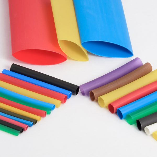 Colorful heat shrink tubing on white background | Class C Components