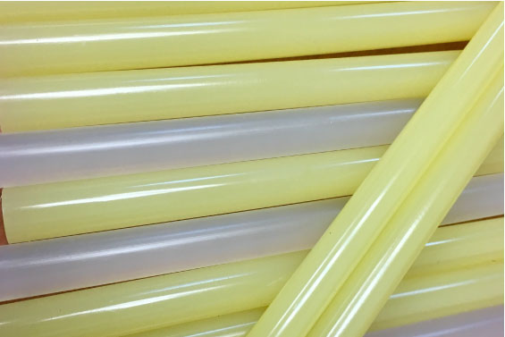 Small pile of yellow hot melt glue sticks | Class C Components
